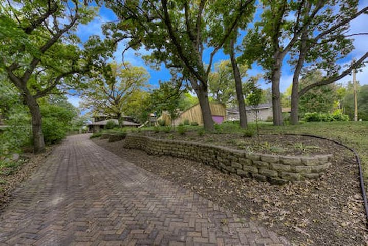 Wonderfully landscaped driveway is only a few steps from Mike's of trails!