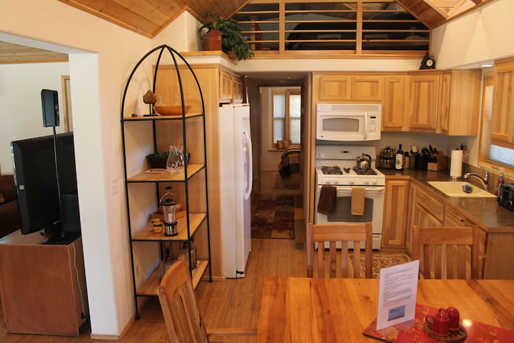 Full kitchen with microwave allows for the perfect romantic or family meal.