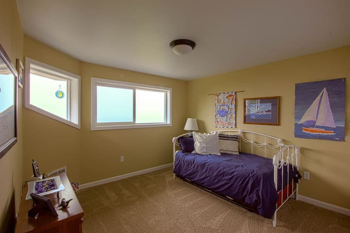 The loft bedroom up the spiral stairs for even more fantastic coastal views.  A day bed and roll out twin bed.