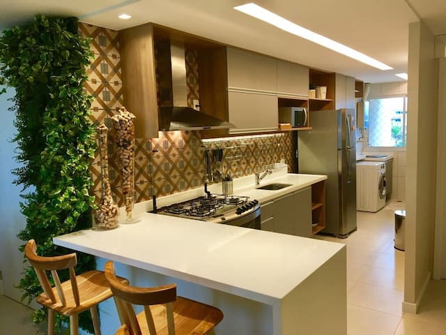 view of the fully furnished kitchen with top level appliances