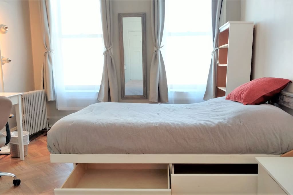 Solid wood bed-frame, high-density foam mattress, and luxury linens. Fresh linens are provided upon request.