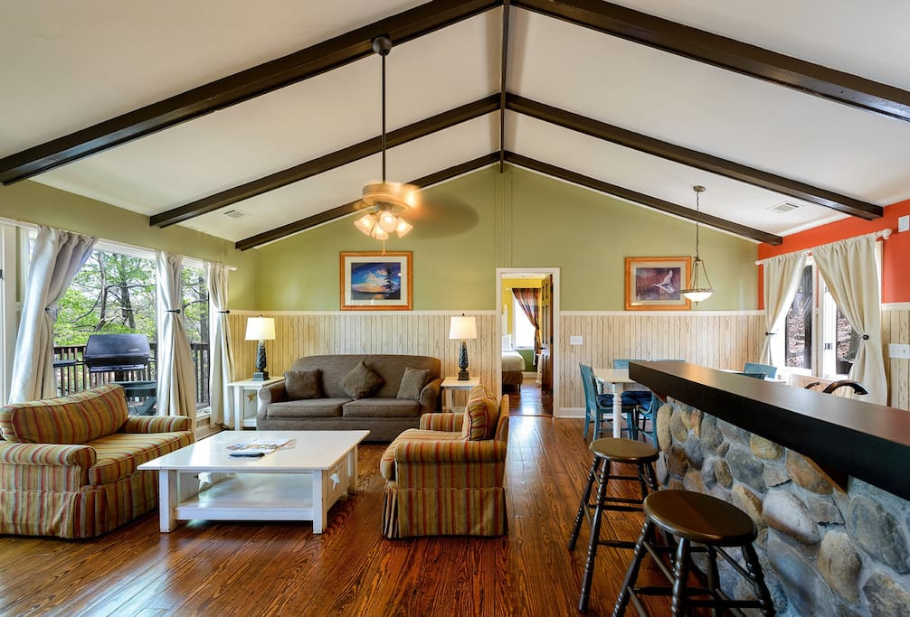 The spacious living room has seating for four on the couches, and six at kitchen table.