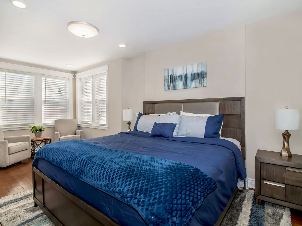 Master Bedroom features a King Bed with comfortable seating area.