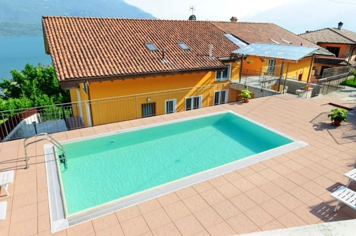 House with 2 bedrooms in Vercana, with wonderful lake view, shared pool, furnished balcony - 2 km from the beach