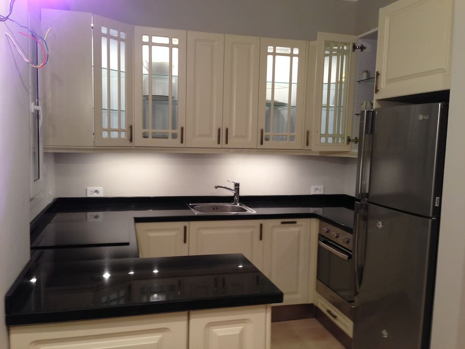 A modern hi qualety kitchen. seramic top. stove. dishwasher. washmacine.Frigde with freese. Enjoy