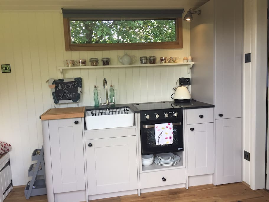 Small but perfectly formed - fridge, oven and hob all contained within the space