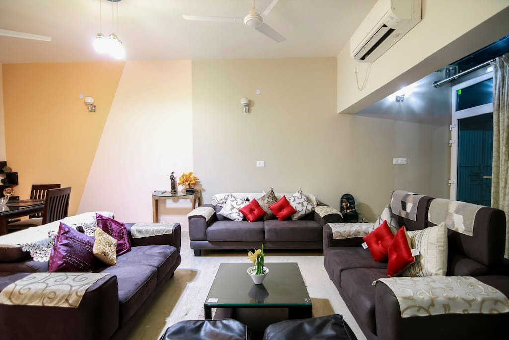 "A Spacious living room with cosy sitting ,ample natural light and beautiful view with 50""TV with over 100 channels access."