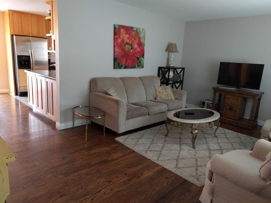 Family room couch, 2 swivel chairs,Flat screen TV, games, cards