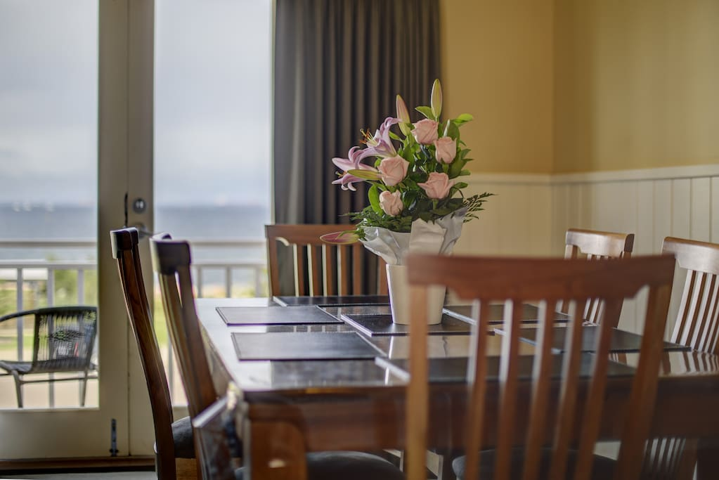 Dining area with views of the Esperance bay from balcony