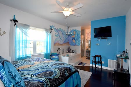 Mermaid Suite at Inn on the Avenue...discover the mermaid in you...in this beautiful suite with a double shower, jacuzzi tub and heated bidet...