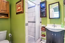 The full bathroom offers a walk-in shower and updated vanity.