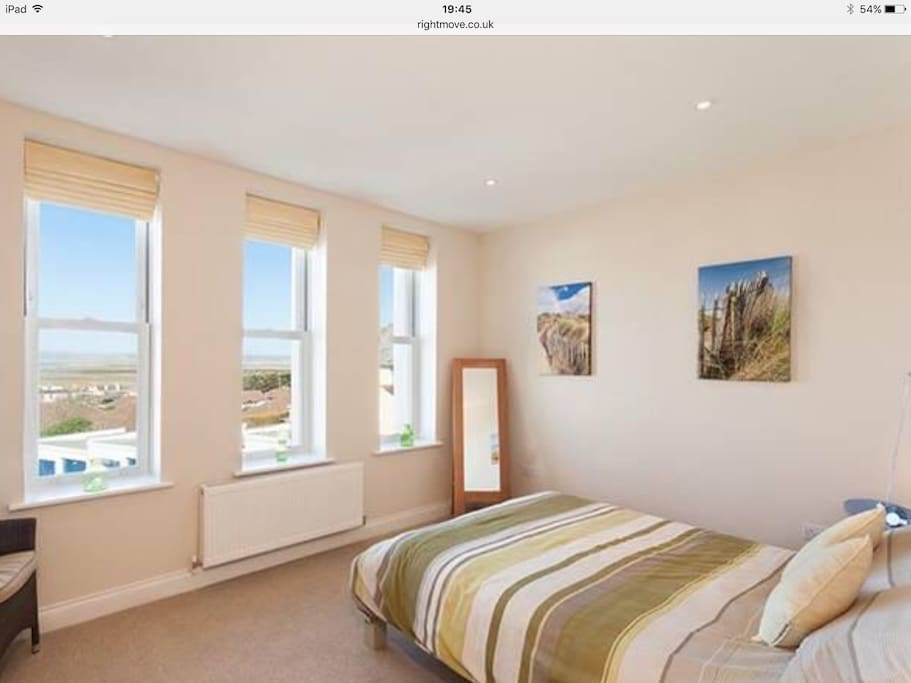 Spacious bedroom with sea views