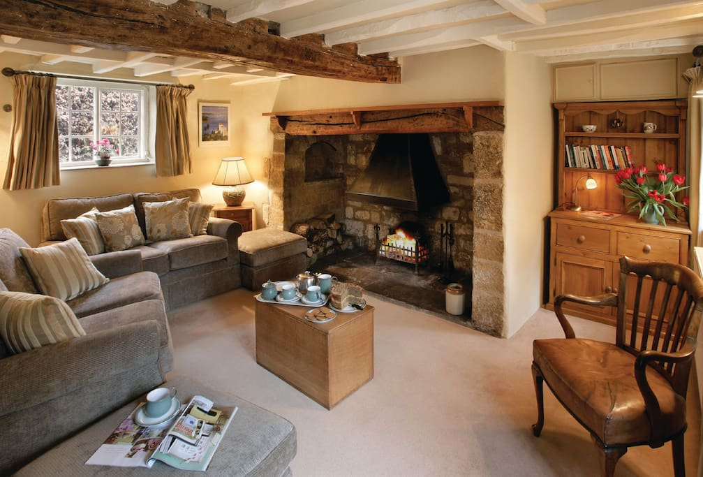 Ground floor: Sitting room with inglenook fireplace and open fire