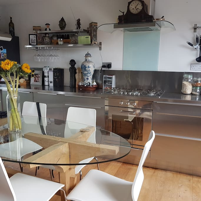 Well equipped Smeg kitchen with 6 person handmade dining table