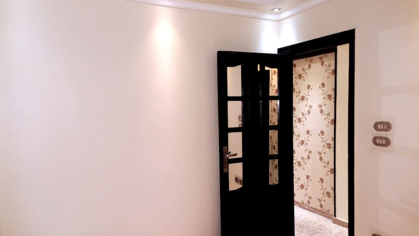 * Second Room  White Wall. * Woody Door With Mirror.