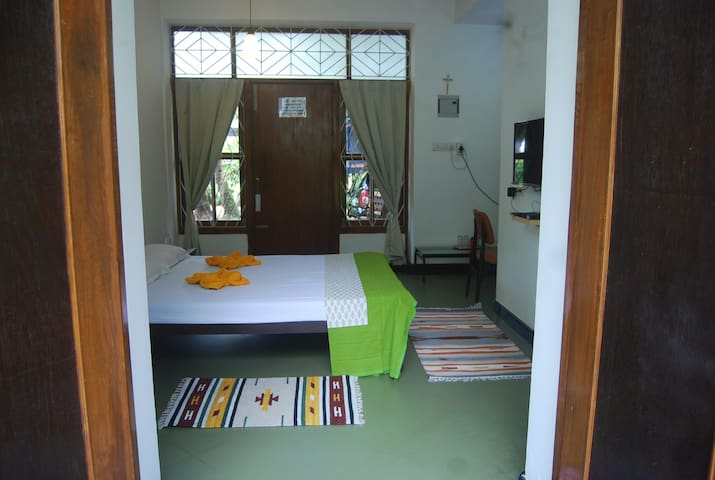 Bed with main entrance door...