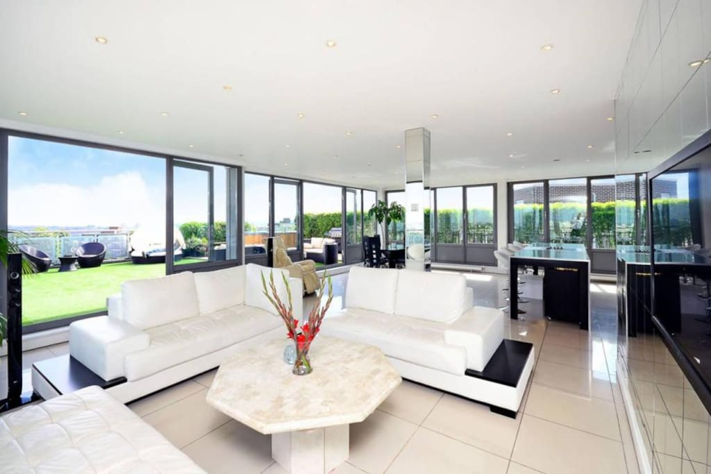 Open Plan Kitchen/Reception with access to Terrace.