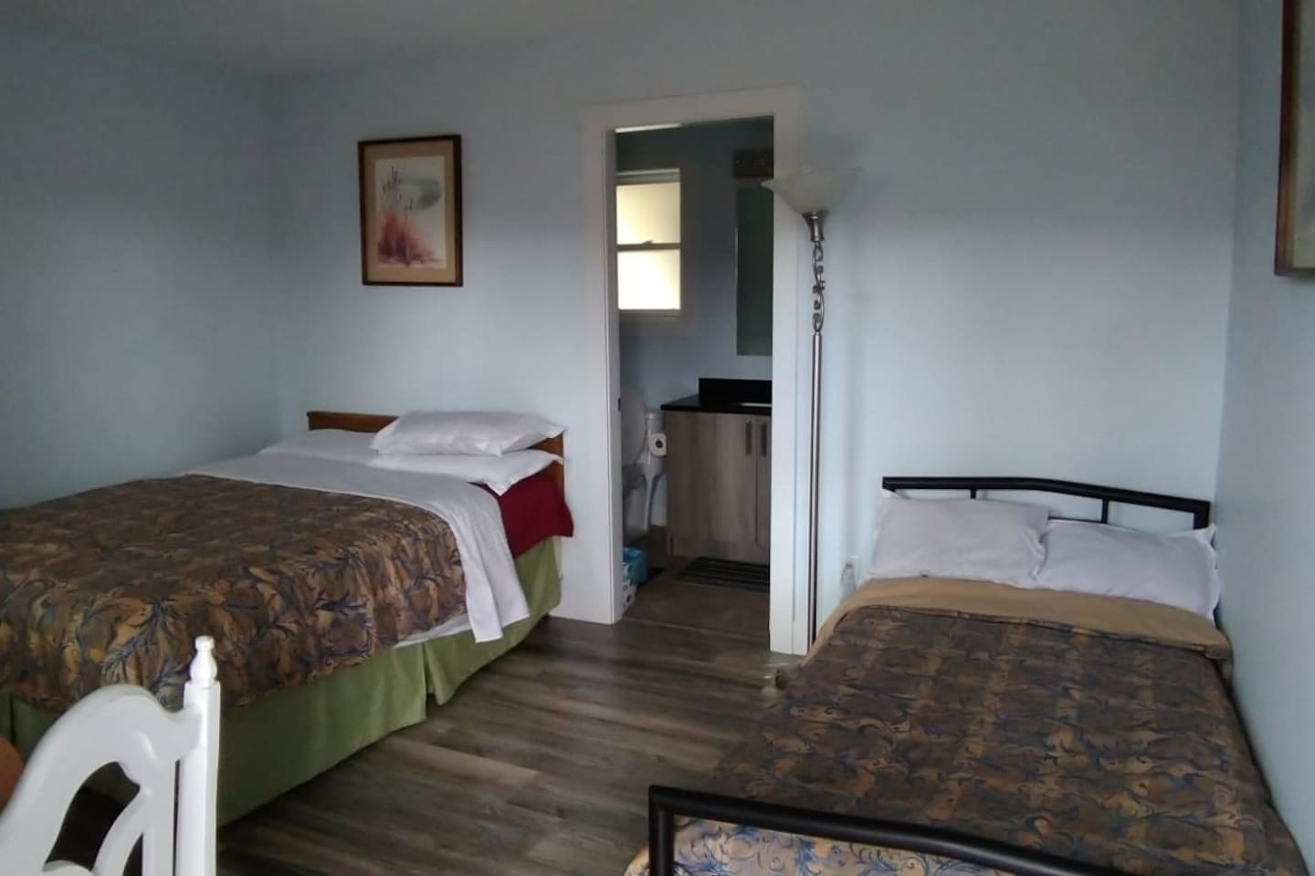 a good size bedroom with 2 beds and other facilities