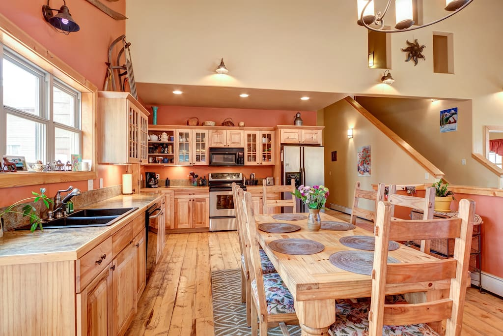 Open entertaining kitchen with one of two dining tables.  Overall sitting for 14 people