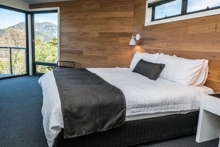 Enjoy the views from your bed. This main bedroom has a comfortable king bed and has it's own ensuite bathroom.