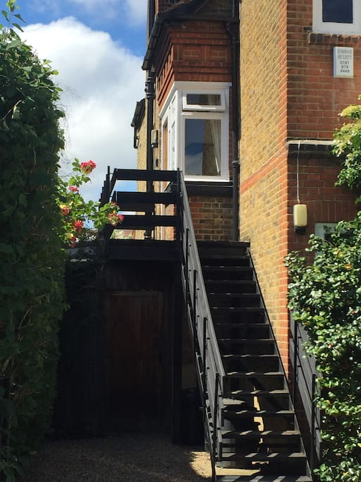 Separate private access up outside staircase