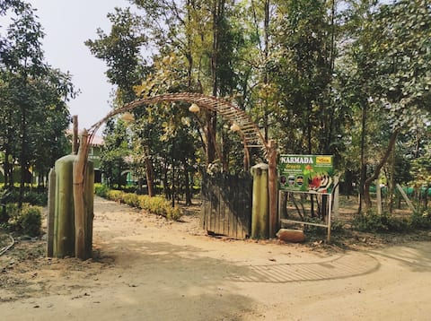 Deluxe double bedroom - forest view-Narmada Greens