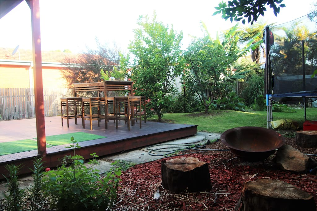 Spacious back deck and entertaining area, trampoline and fire pit!