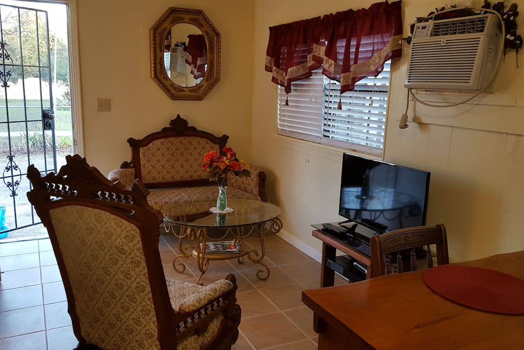 Living room area with cable television.