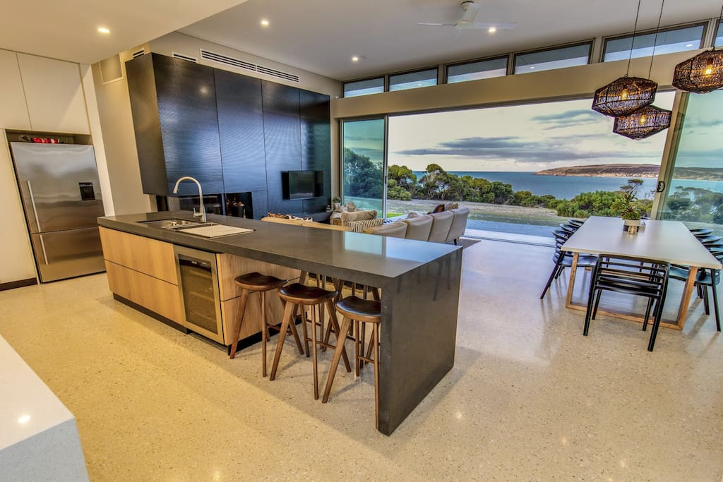 Kitchen with bar fridge, microwave, gas cooktop, fridge with plumbed water and ice machine