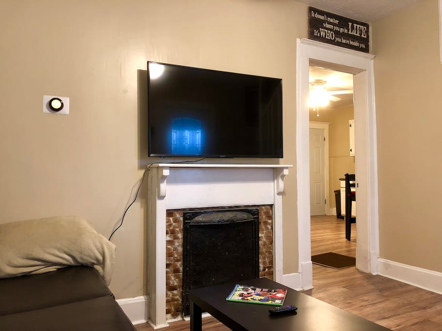 Living room with smart tv and smart thermostat. The tv has preinstalled apps for your viewing pleasure. Most popular networks, sports, and movie channels are ready to be watched. You can use your own Netflix account if you would like.
