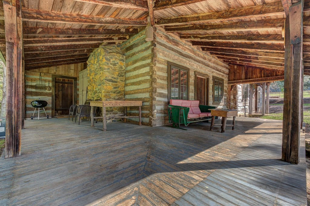 The large wraparound porch is perfect for relaxing, telling stories, and soaking up the beautiful scenery that our property offers.