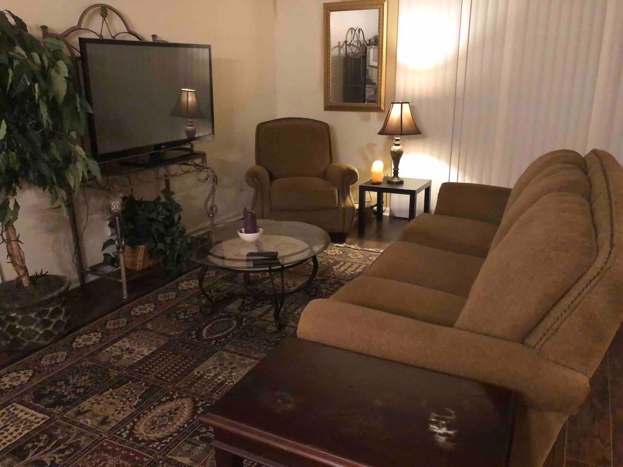 "Living room with comfy 3 person sofa, great recliner and a 50"" TV perfect for movie watching"