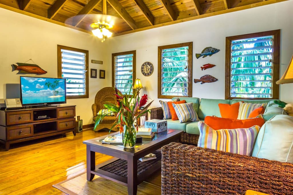 Caribbean cottage with traditional louvered windows and tons of island charm.
