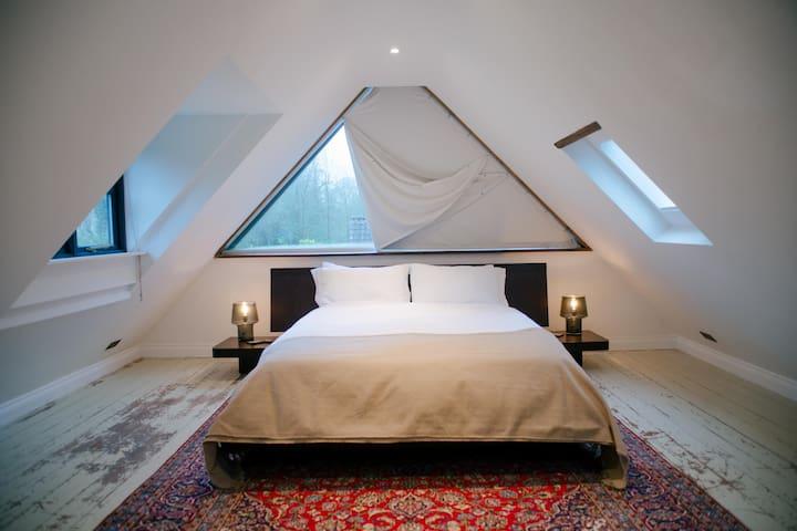 Top floor bedroom suite with huge picture window & garden views
