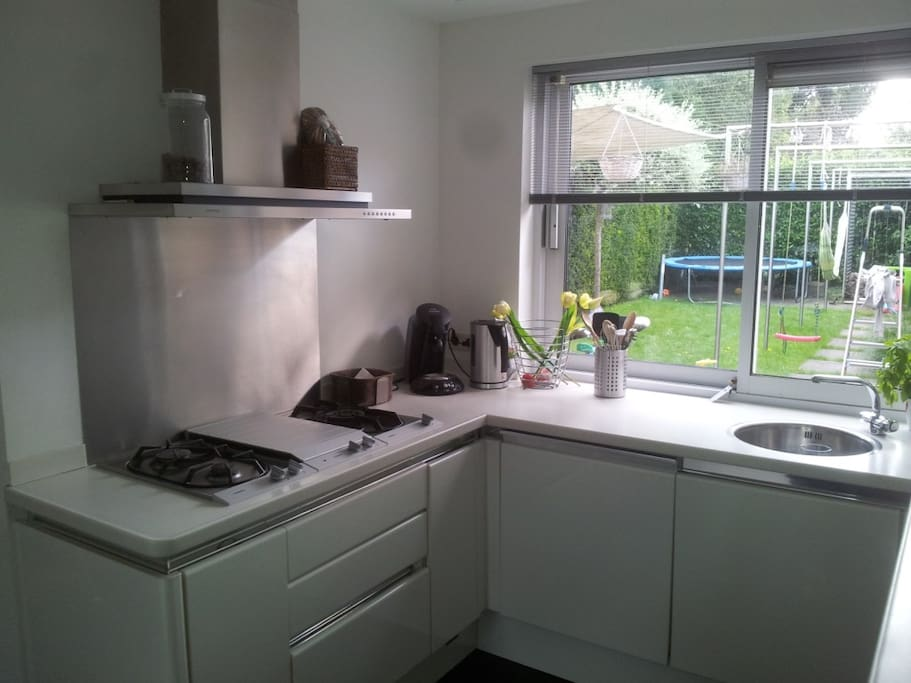 kitchen with microwave and oven and two sinks