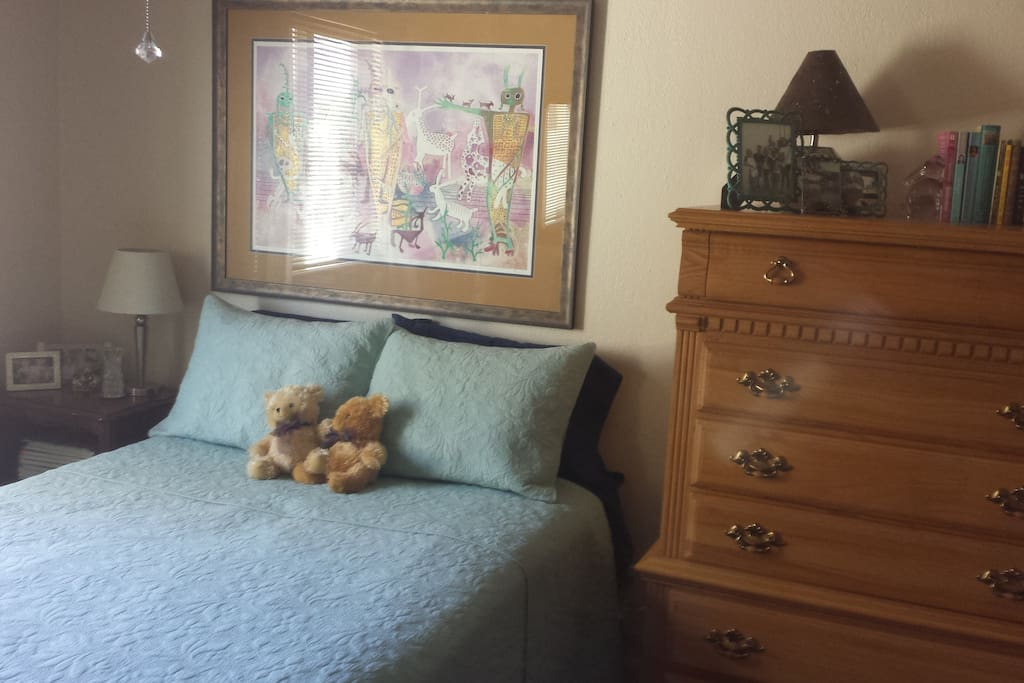 Spacious, comfy guest room with queen bed, highboy dresser and large closet