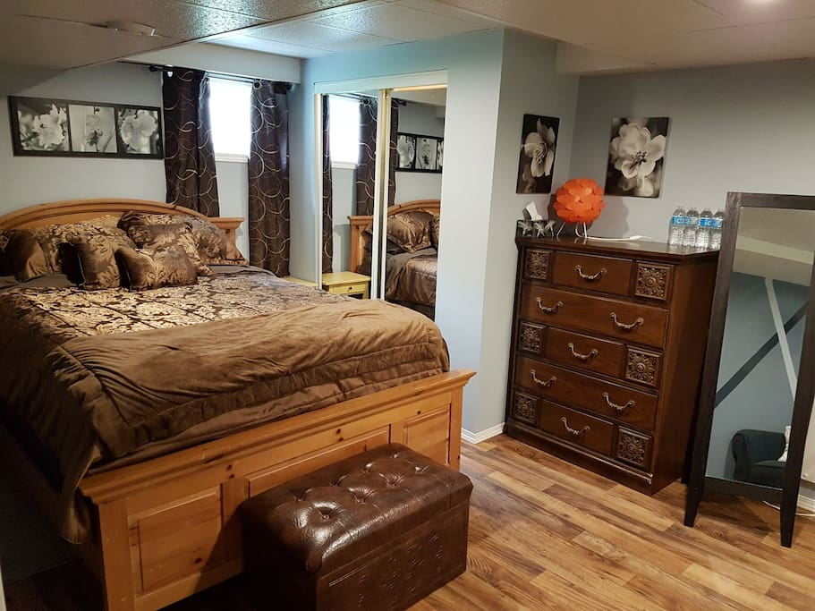 Private bedroom with brand new queen mattress, closet and dresser.