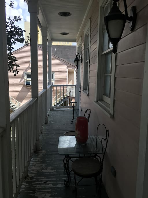 Shaded balcony offers cool breezes in summer , great for having morning coffee or a glass of wine after a long day of work or a wonderful day of  festivities .