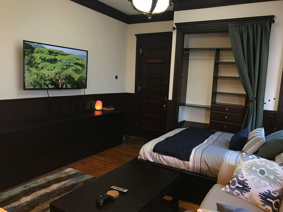 Netflix & Hulu all available on a wall-mounted HD TV.