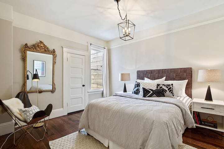 Master bedroom. There is also a desk and a large white armpit for additional storage both hanging and with drawers.