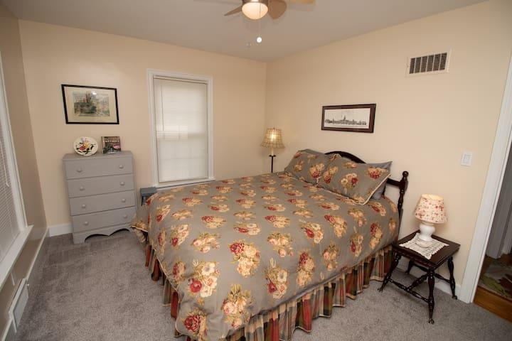 Queen bed, dresser, ample room, french door closet.