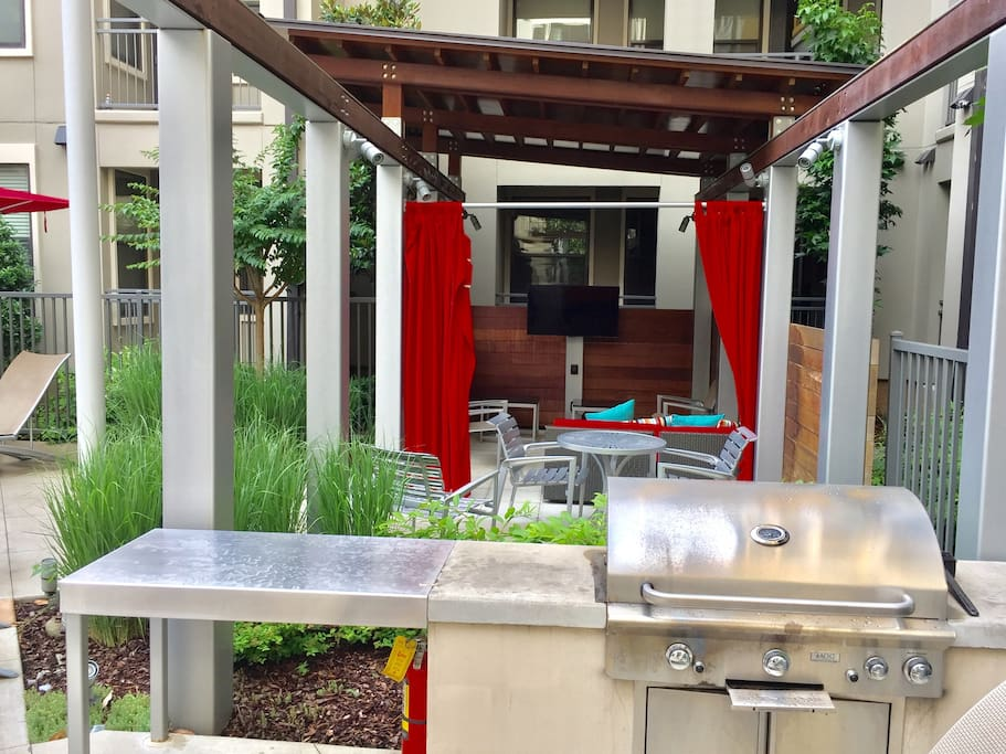 Cabana, TV, and grilling area by the pool!!