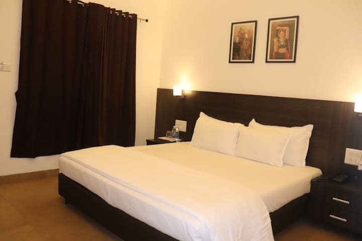 Comfortable Deluxe Room at Alibag
