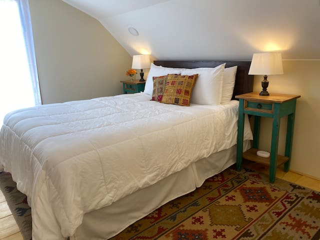 Queen bed in the loft offers beautiful sunrise views