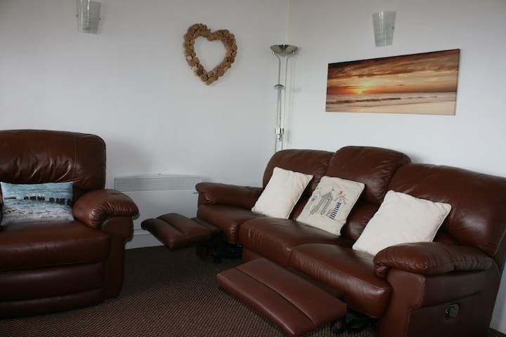 Comfy sofa to relax & put your feet up.