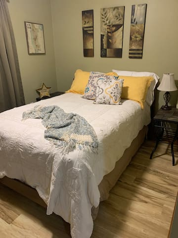 Bedroom 2 - full sized bed with 4 pillows.