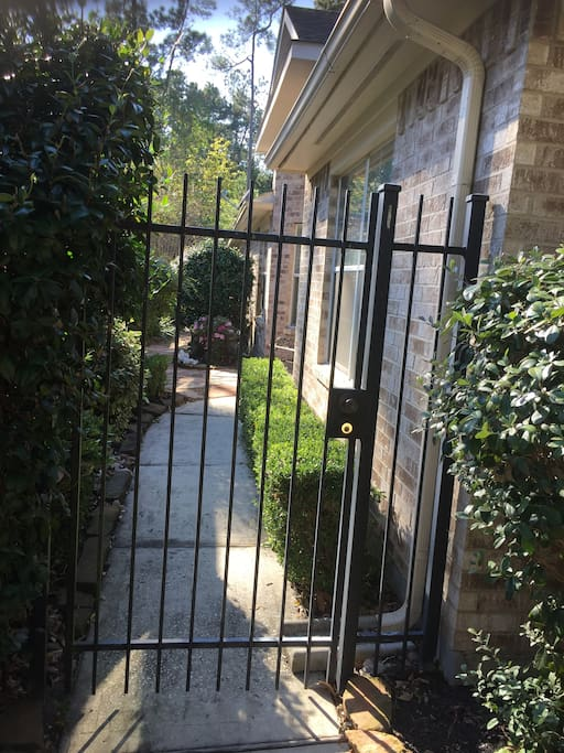 Gate entrance, front door inside to the right