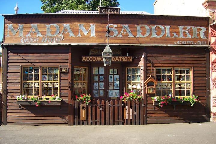 Madam Saddler Corset Cottage