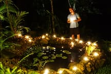 Enjoy an evening around the candle-lit native lotus pond