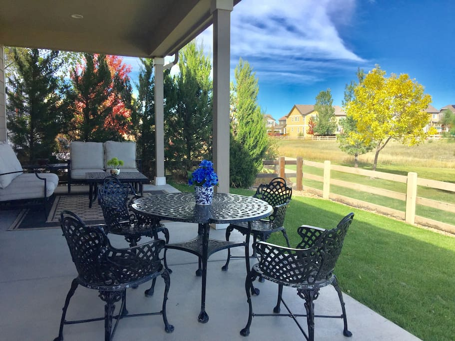 Covered patio in an open space backyard.  Another access that you can enjoy your meal or simply relax, recharge..